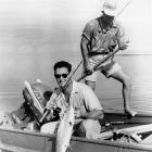 Posing for the camera, Ted Williams displays a bonefish he caught in Florida, 1955.