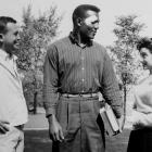 Jim Brown talks with fellow students Chuck Meyer and Phyllis Goldstein on Syracuse University campus in 1956. Brown had suffered a cut on his forehead in a 26-12 upset victory over Maryland.