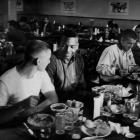 Jim Brown shares a meal with Syracuse quarterback Chuck Zimmerman in 1956. That season Brown rushed for 986 yards with 14 touchdowns in just eight games and was named a first-team All-America. He also finished fifth in the Heisman Trophy voting.