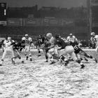 Jim Brown tries to escape a tackle from the New York Giants' Ray Wietecha in the snow at Yankee Stadium in 1958. Brown gained 148 rushing yards in the game, 65 of them coming on a touchdown run in the first quarter for Cleveland's only touchdown. The Browns lost just four games that season, three to the Giants, including a 10-0 defeat in the playoffs.