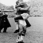 Pelé celebrates as Brazil defeats hosts Sweden, 5-2, in the 1958 World Cup final.  Pelé scored twice on a day that saw him become the youngest player to ever score in a World Cup final (a record that stands to this day).