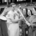 Colavito, seen here giving hitting instructions to nuns attending a game, went a perfect 4-for-4 with a walk in the Cleveland Indians' 11-8 victory. Like Josh Hamilton, his game came against the Orioles in Baltimore.
