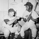 """Elijah """"Pumpsie"""" Green, the first African-American to ever play for the Red Sox, gets some pointers from Ted Williams in 1959."""