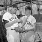 A 26-year-old Roger Maris and 42-year-old Ted Williams pose before a game in 1960.