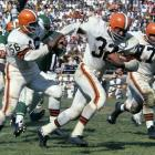 Jim Brown springs up field surrounded by blockers against the Philadelphia Eagles in 1961. Brown gained 140 yards from scrimmage in Cleveland's 27-20 loss in the season opener.