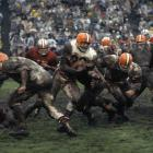 Jim Brown runs through the mud and the 49ers defense in a game in San Francisco in 1962. Although he failed to earn All-Pro distinction for the only time in his career, Brown still gained 1,513 yards from scrimmage with 18 total touchdowns and was selected for the Pro Bowl.
