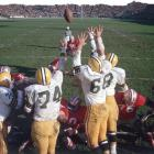 The Packers' grasp exceeded their reach as they tried to knock down a chip shot by 49ers kicker Tommy Davis.