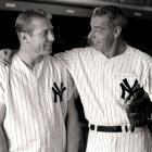 Mickey Mantle poses with Joe DiMaggio after DiMaggio played in an old-timers game on July 26, 1963 at Yankee Stadium.
