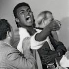 """A seemingly hysterical Clay taunted Sonny Liston during the pre-fight physical for their 1964 bout. He had consistently baited the Big Bear during the lead-up to the fight, saying he was going to """"use him as a bearskin rug ... after I whup him."""" The Miami Boxing Commission would fine Clay $2,500 for his outburst at the physical."""