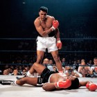 """In one of the most iconic and controversial moments of his career, Ali stands over Sonny Liston and yells at him after knocking the former champ down in the first round of their 1965 rematch. Skeptics dubbed it """"the Phantom Punch,"""" but films show Ali's flashing right caught Liston flush, knocking him to the canvas. Refusing to go to a neutral corner, Ali stood over Liston and told him to """"get up and fight, sucker."""""""
