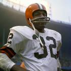 Jim Brown stands alone on the sideline during a game against the Eagles in 1965, the final season of his career. Brown rushed for 1,554 yards with 17 touchdowns that season, including 131 yards and three total touchdowns against the Eagles in a November matchup.