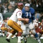 Alex Karras looks to sack Sonny Jurgensen during the Detroit Lions game against the Washington Redskins on Oct. 3, 1965 in Detroit.