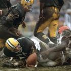 Packers linebacker Ray Nitschke recovers a Jim Brown fumble during the NFL Championship at Lambeau Field.