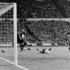 Geoff Hurst turns away and celebrates after completing what remains as the only hat trick ever recorded in a World Cup final.  The historic achievement was the highlight of a greater achievement -- the first and only World Cup victory for England.