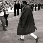 Pelé walks off in pain after injuring his shoulder against Portugal during their match at the 1966 World Cup.