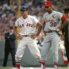 Carl Yastrzemski stands on first base as St. Louis Cardinals first baseman Orlando Cepeda looks on during Game 1 of the World Series at Fenway Park in Boston on Oct. 4, 1967.
