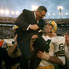 Jerry Kramer and Forrest Gregg carry head coach Vince Lombardi off the field after the Packers' 33-14 win over the Oakland Raiders. The victory, Green Bay's second straight Super Bowl triumph, was Lombardi's final game as the Packers' coach.
