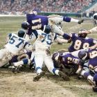 Vikings back Dave Osborn took a lick from the Rams' Deacon Jones (75) but still scored.