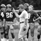 Redskins quarterback Sonny Jurgensen (9) and teammates listen to head coach Vince Lombardi at R.F.K. Memorial Stadium.