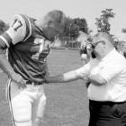 Jets head coach Weeb Ewbank pokes the stomach of Dave Foley on the first day of training camp at Hofstra University in Hempstead, N.Y.