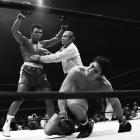After a long, often sloppy bout, Ali -- here being held back by referee Mark Conn -- produced one of the most dramatic finishes of his career, dropping Bonavena three times in the 15th and final round to automatically end the fight. The win cleared the way for a showdown with Joe Frazier, the man who had taken the heavyweight title in Ali's absence.