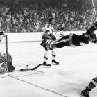 It is, without doubt, the most iconic image in hockey history: Bobby Orr of the Boston Bruins sailing through the air after being tripped by Noel Picard of the St. Louis Blues. Orr had just put the puck past goalie Glenn Hall in overtime of Game 4, giving Boston a 4-3 win, a series sweep, and its first Stanley Cup since 1941.
