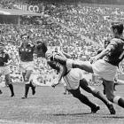 Mexican forward Horacio Lopez Salgado hits a diving header under pressure from Soviet Union's defender Gennadi Logofet during the opening match of the 1970 World Cup.