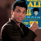 Ali poses with the fight poster for his upcoming fight against Jimmy Ellis during a photo shoot in July 1971. Ellis was an old friend of Ali's — both were trained by Angelo Dundee — and knew his fighting style well from many rounds of sparring.