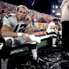 Bradshaw takes a call from the bench during a rough loss to the Chiefs, 38-16, in 1971.