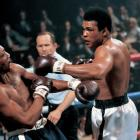 Ali throws a left hook at Bob Foster in their 1972 fight at Stateline, Nev. Although Ali knocked Foster out, Foster did leave his mark: a cut above Ali's left eye, his first as a professional.
