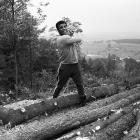 """Ali chops wood at his cabin in Deer Lake. He referred to the training camp as """"fighter's heaven"""" and used it to prepare for fights away from the spotlight."""
