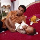 Ali changes the diaper of his son in his bedroom during a photo shoot at the family's home in April 1973. Ali had suffered a broken jaw less than a month earlier in his fight against Ken Norton.