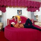In the wake of his split decision loss to Norton, Ali plays with his son in his bedroom at home in Cherry Hill, N.J.