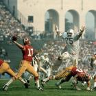 Miami Dolphins defensive tackle Manny Fernandez pursues Washington Redskins quarterback Billy Kilmer, who had three interceptions and no touchdowns against a stingy Miami defense. Washington's only touchdown came on a 49-yard fumble return in the team's 14-7 loss to the Dolphins.