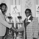 """While at Jackson State University, Walter Payton broke the NCAA scoring record with 65 career touchdowns. Here, Payton shakes hands with Tennessee State defensive tackle Ed """"Too Tall"""" Jones in 1973. The two were selected to head the first black college All-America football team."""