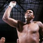 Ali points before his bout with Foreman. The victory over his favored opponent made him the heavyweight champion of the world for the first time since he was stripped of his titles in 1967.
