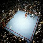 George Foreman went 40-0 as a professional boxer on March 26, 1974. Foreman defended his heavyweight title almost effortlessly as he belabored Ken Norton into senselessness in five minutes with a TKO in the second round. Leifer captured this aerial view of the fight in Caracas, Venezuela.