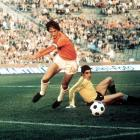 """Dutch star Johan Cruyff fakes out a goalkeeper and scores in the 1974 World Cup.  Cruyff invented """"the Cruyff turn,"""" one of soccer's coolest and most devastating tricks, cementing his place in soccer history."""