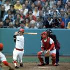 Carl Yastrzemski bats as Cincinnati Reds catcher Tim McCarver looks on during Game 1 of the World Series at Fenway Park in Boston on Oct. 11, 1975.