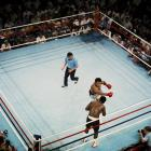 """Frazier faces an Ali right hook in their fight in Quezon City, Philippines. The two fighters traded vicious blows during their 14 rounds. """"Man, I hit him with punches that'd bring down the walls of a city,"""" Frazier said. Ali withstood the blows to win by TKO in the 15th round."""