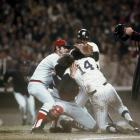Carl Yastrzemski tries to break up a fight between teammate Carlton Fisk and the New York Yankees' Lou Piniella during a game at Yankee Stadium in New York on May 20, 1976. Piniella was out at home, but the collision started a bench-clearing brawl.