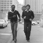 Walter Payton jogs down the street in Chicago with his teammate, Bears linebacker Doug Buffone, on Dec. 15, 1977.