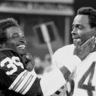 Cleveland Browns running back Eddie Payton (left) meets with his younger brother, Chicago Bears running back Walter Payton, following a preseason game on Aug. 25, 1977 at Cleveland Municipal Stadium.  Eddie mostly returned kicks and punts during his five years in the NFL.