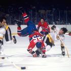 Parking a carcass: Boston defenseman Brad Park sent Montreal's Jacques Lemaire tumbling to the ice with this hard hit in Game 6. Park was one of a record-setting 11 Bruins who scored at least 20 goals that season, but Lemaire's Habs came away with a 4-1 Cup-clinching win at Boston Garden.