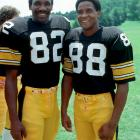Steelers wide receivers John Stallworth (82) and Lynn Swann pose during training camp at St. Vincent College in Latrobe, Penn.