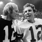 Bradshaw chats with Cowboys quarterback Roger Staubach after a preseason game in Irving, Texas, in Aug. 1979.