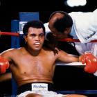 Drew Bundini Brown leans in to speak to Ali, who returned to fight Holmes after a brief retirement. By this time, Ali had already begun developing a vocal stutter and trembling hands and taken thyroid medication to lose weight that left him tired and short of breath.