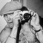A candid Bradshaw poses for the camera, with a camera.
