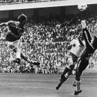 England's Bryan Robson heads the ball past French goalkeeper Jean Ettori to score his second goal of the match en route to England's 3-1 defeat of France in the 1982 World Cup.