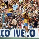 Brazilian midfielder Socrates celebrates with teammate Zico on his back after scoring an equalizing goal, knotting the score at 1-1 against Italy.  Italy would triumph in the end however, on its way to becoming champions.